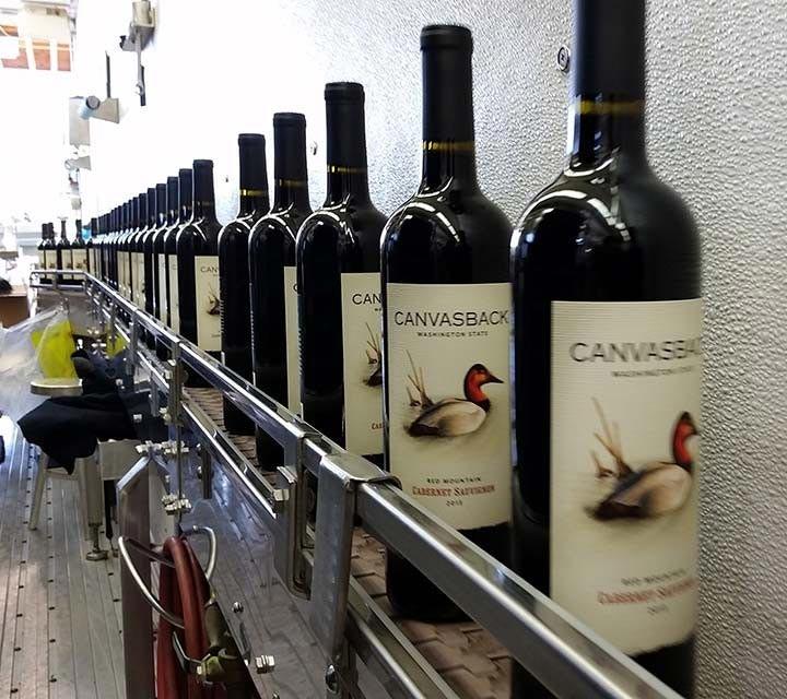 Canvasback bottles on bottling line