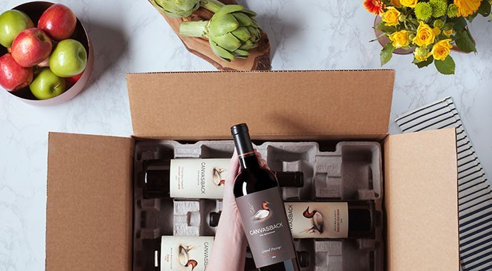 Open box with bottles of Canvasback