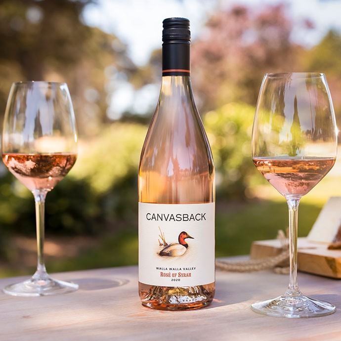 Canvasback Rose outside with two glasses