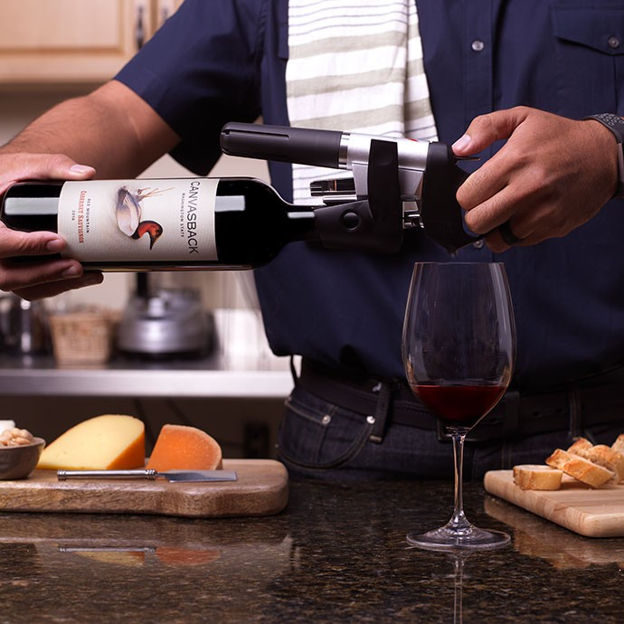 Canvasback wine being coravin