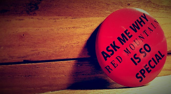 Button that reads, ask me about red mountain